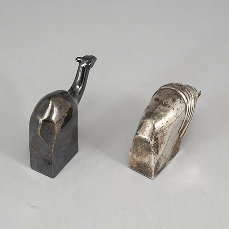 Two electro plated zinc figurines from dansk designs, japan.