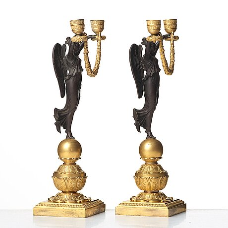 A pair of empire two-light candlesticks, beginning of the 1800's.