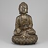 A chinese silvered cast iron figure, 20th century.