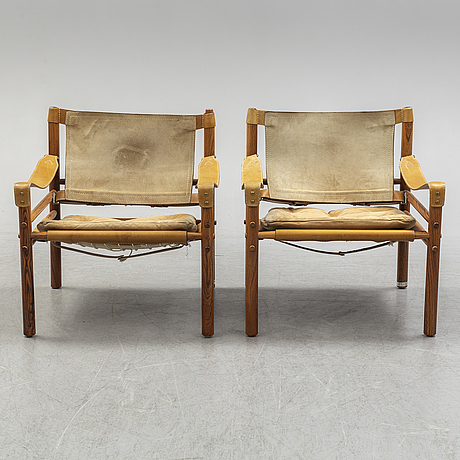 Arne norell, a pair of rosewood 'sirocco' easy chairs from norell möbel ab, 1960's/70's.