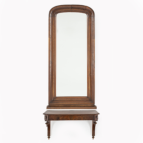 A late 19th century mirror and shelf.