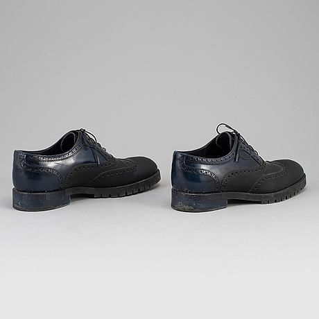 Louis vuitton, a pair of rubber and patent leather brogues, size 10.