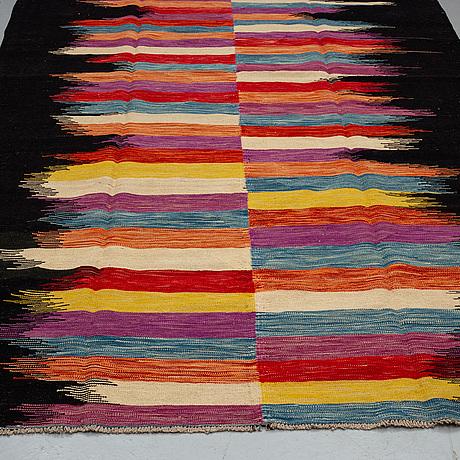 A carpet, kilim 302 x 197.