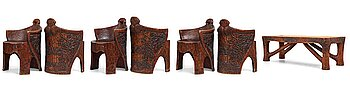 """235A. Gustaf Fjaestad, an Art Nouveau carved and sculptured table and 6 """"stabbestolar"""" chairs, Arvika, ca 1908-1914."""