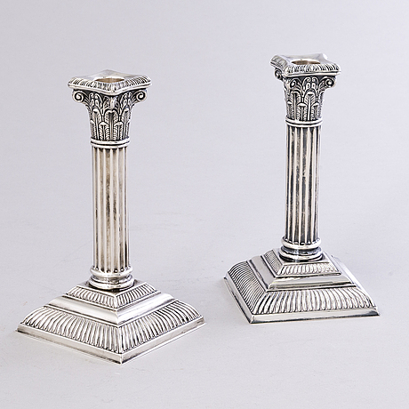 A pair of candle sticks in silver by auran kultaseppä oy, turku, finland, 1968 and 1979.
