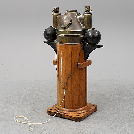 A brass binnacle from instumentfabriks ab lyth, stockholm, first half of the 20th century.