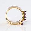 A 14k gold ring with garnets. kalevala koru 1960.