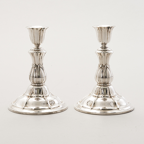 A silver 3-flame candelabrum and two pairs of silver candlesticks, finnish hallmarks, 1930s and 1954.