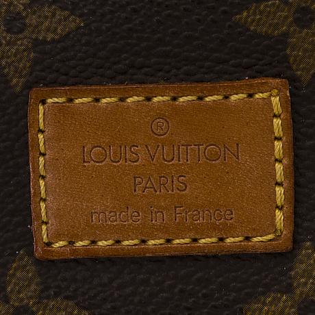 Louis vuitton monogram canvas saumur 35 bag.
