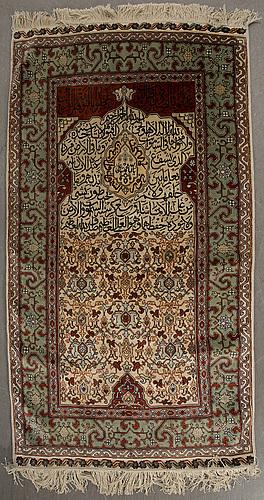 A hereke silk carpet part relief ca 142 x 77 cm.
