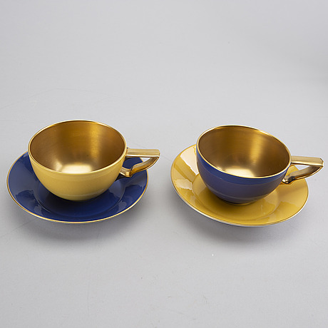 """Karin bjÖrquist, a set of two """"the queens cup"""" rörstrand porcelain."""