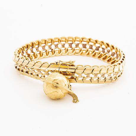 Bracelet 18k gold w 1 charm, 46,1 g.