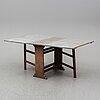A mid 19th century gate leg table.