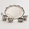 A sterling silver tray and two different pairs of a silver sugar bowl and a silver cream jug.