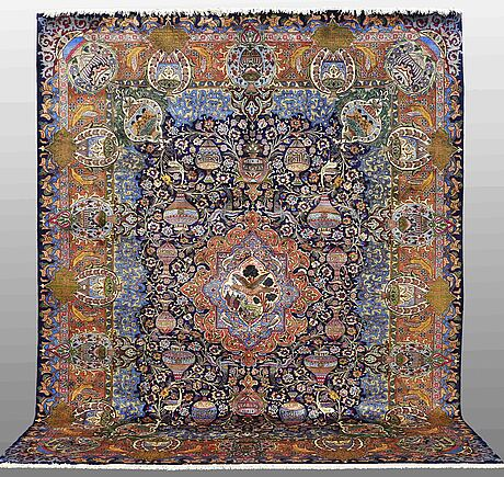 A carpet, figural kashmar, ca 396 x 304 cm.