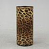 Fornasetti, a leopard print tin umbrella stand, milan, italy.