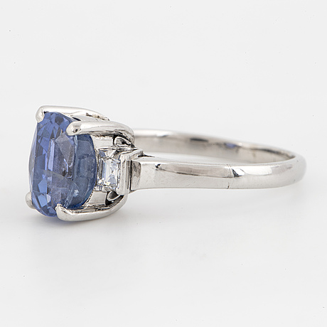 Oval mixed-cut sapphire and step-cut diamond ring.