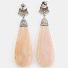 Drop shaped coral and brilliant-cut diamond earings.