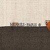 HermÈs, a 'chasse à vol' silk and cashmere scarf.