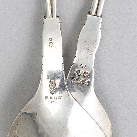 Georg jensen, a pair of silver spoons, mid 20th century.