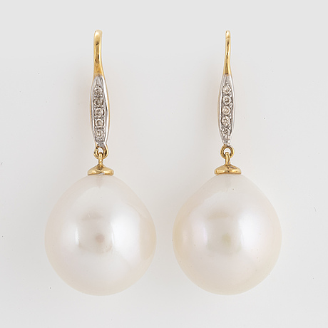 Cultured freshwater pearl and diamond earrings.