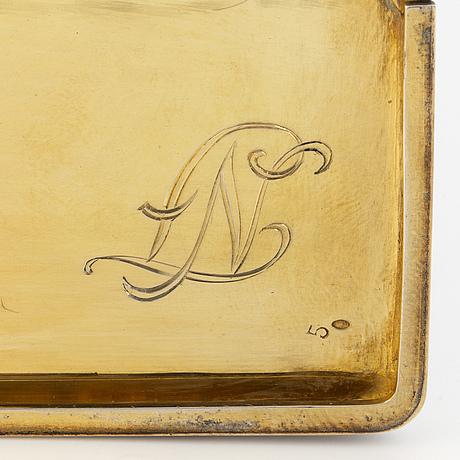 An enamel and silver-gilt cigarette case.