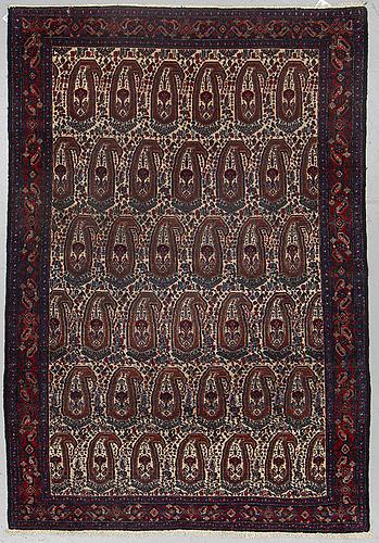 A rug, semi-antique senneh, ca 203 x 137 cm.