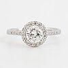 Brilliant-cut diamond halo ring.