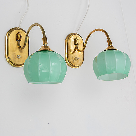 A pair of ajh wall lamps from the mid 20th century.