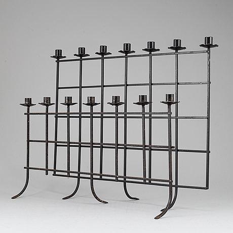 Two iron candelabras, 20th century.