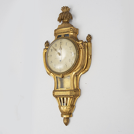 A gustavian wall clock by jacob kock, late 18th century.