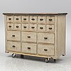 A circa 1900 painted chest of eighteen drawers.