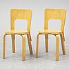 Alvar aalto, a pair of model 66 birch chairs from artek, finland.