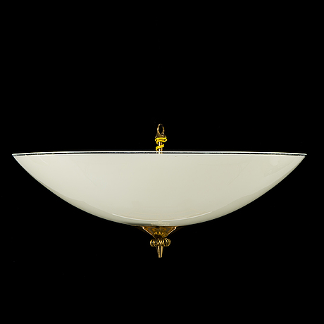 A mid-20th century ceiling light for itsu finland.