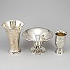 Two silver beakers and a bowl.