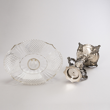 A late 19th-century centrepiece in nickel silver with cut glass bowl.
