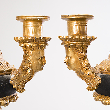 A pair of empire-style candlesticks, late 20th century.