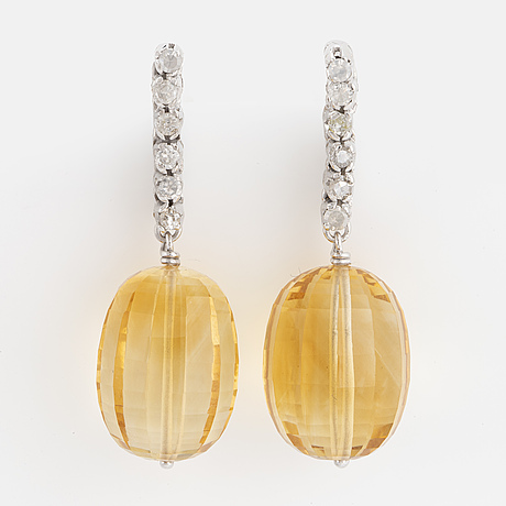 Briolette-cut citrine and single-cut diamond earrings.