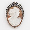 Carved sea shell cameo with rose-cut diamonds and sapphire brooch/pendant.
