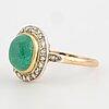 Cabochon-cut emerald and rose-cut diamond cluster ring.