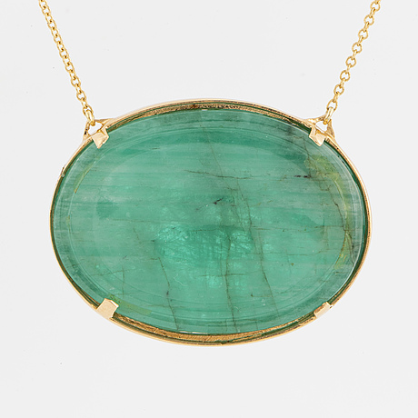A carved emerald necklace.