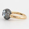 Pomellato ' tabou' ring, 18k gold and silver with blue topazes.