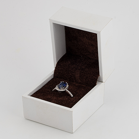 18k white gold and sapphire and brilliant-cut diamond cluster ring.