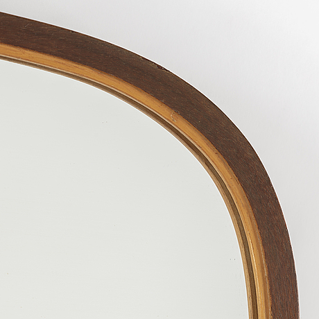A swedish modern mahogany and birch framed mirror, 1940's.