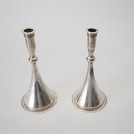 A pair of 20th century swedish sterling silver candle sticks mark of w nilsson lund 1959, weight 768 gr.