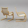 Alvar aalto, a pair of model 406 arm chairs, late 20th century.