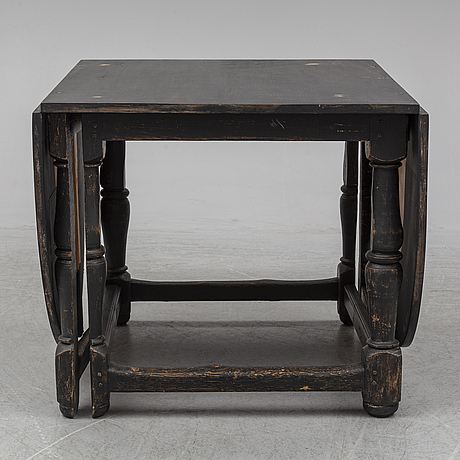 A painted pine baroque style gate leg table, 20th century with older parts.