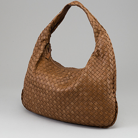 Bottega veneta, a light-brown leather bag.