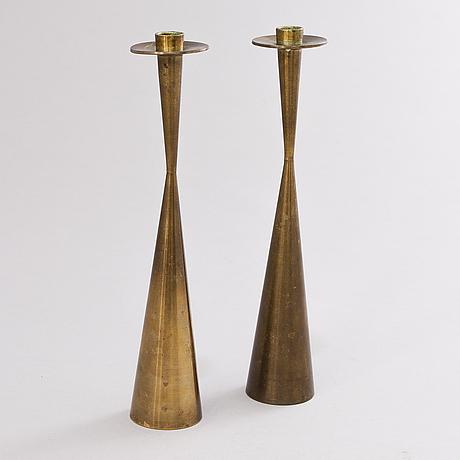 Tapio wirkkala, a pair of bronze candle holders, marked design tapio wirkkala, kultakeskus oy.