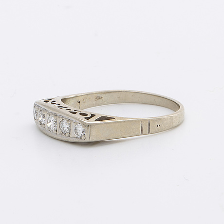 Ring 5 brillliant-cut diamonds 0,25 ct in total inscribed.